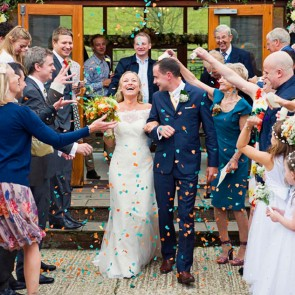 Newlywed celebrations outside The East Barn