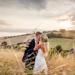 The bride and groom enjoy the countryside surrounding at the Sussex wedding venue