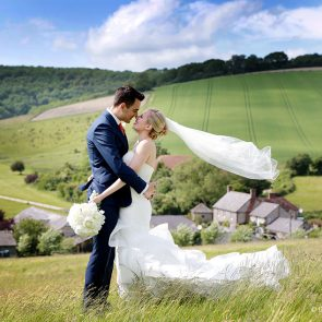 Newlyweds enjoy the countryside that surrounds Upwaltham Barns wedding venue in Sussex
