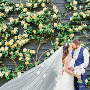 Newlyweds in the courtyard at Upwaltham Barns wedding venue in Sussex