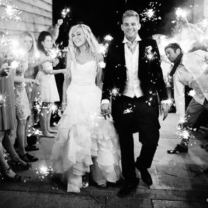 Newlyweds enjoy a wedding sparkler exit at Upwaltham Barns