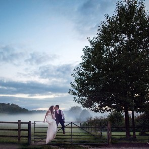 A misty wedding photo at Upwaltham Barns wedding venue in Sussex