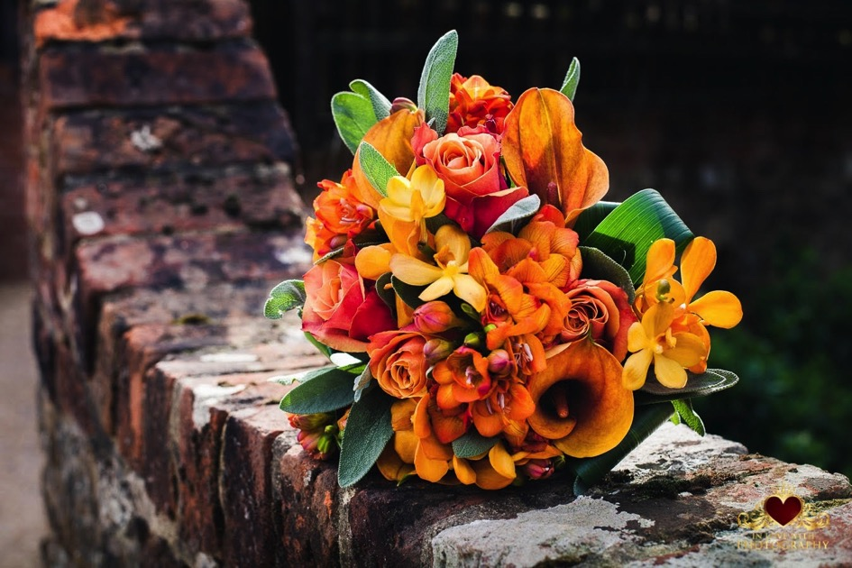 Orange Flower Arrangement At Upwaltham Barns