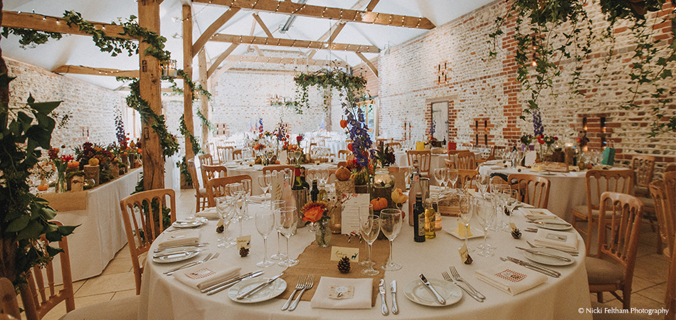 The south barn is set up for an autumn inspired wedding reception