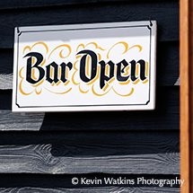 A sign showing that the Stable Bar is open
