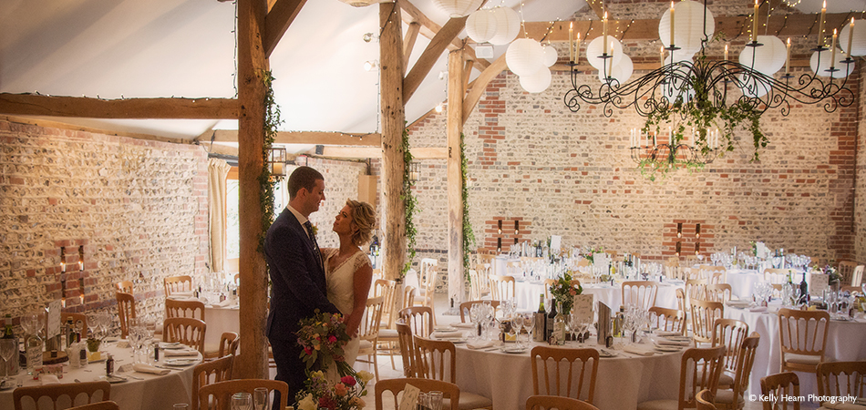 The bride and groom enjoy a moment in the South Barn before guests arrive for the wedding breakfast