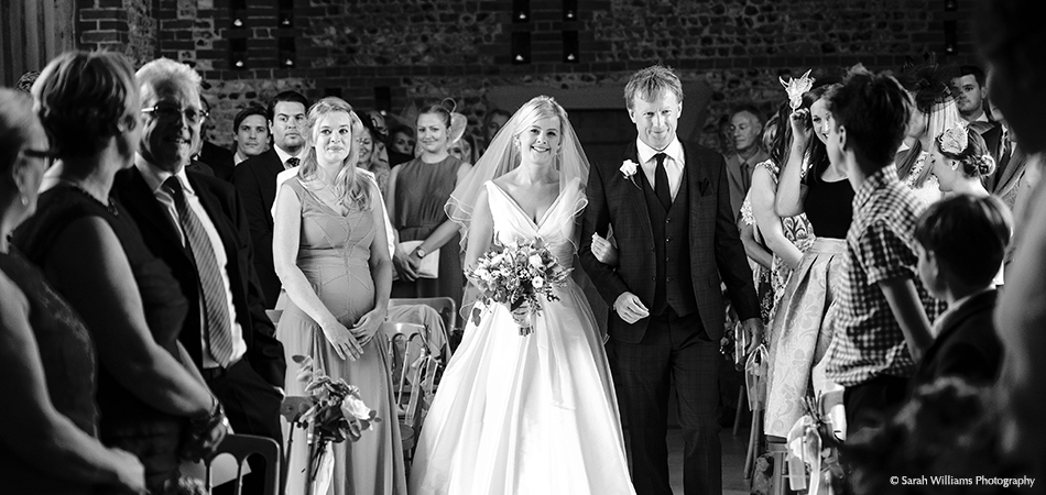The stunning bride walks down the aisle ready for the civil ceremony at Uplwaltham Barns