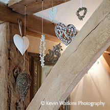 Delicate heart ornaments add detail to the Jasmine Cottage at Upwaltham Barns