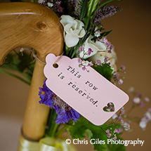 A reserved seating tag within floral decorations adds