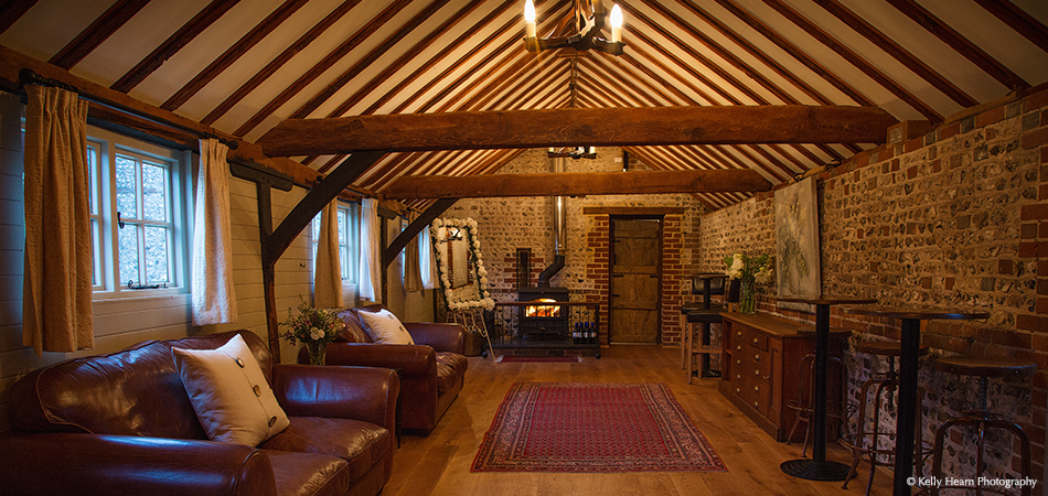 The Stable Bar at Uplwaltham Barns boasts wooden beamed ceilings for that cosy country feeling