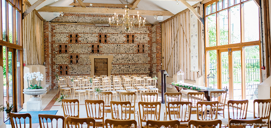 The light filled wedding barn at Upwaltham Barns is set up for a stunning civil ceremony