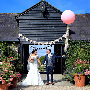 Bride and groom leaving the wedding venue Upwaltham Barns