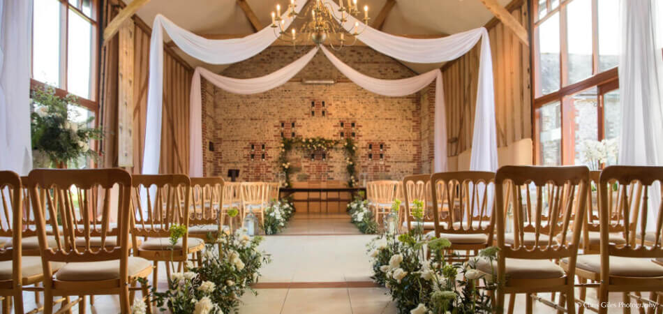 The East Barn all set up for a wedding ceremony at Upwaltham Barns