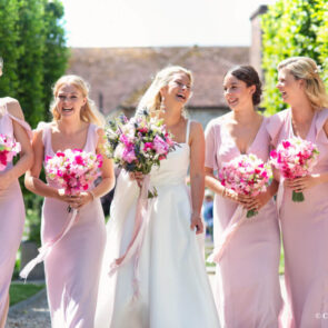 The Bride with her bridesmaids in the courtyard at Upwaltham Barns