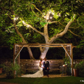 Bride and groom enjoying the evening in the garden