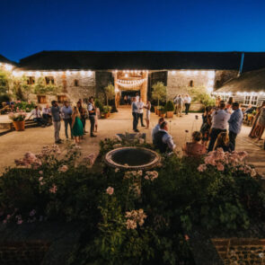 Guest enjoying the courtyard in the evening at Upwaltham Barns