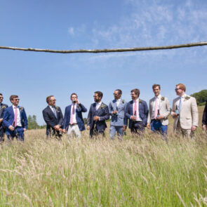 Groom and best men in the field at Upwaltham Barns