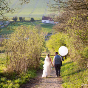 Couple walking down the country lane at Upwaltham Barns