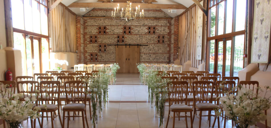 The East Barn at Upwaltham Barns set up for a wedding ceremony