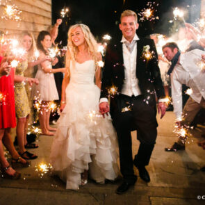Wedding couple at upwaltham Barns in the evening with sparklers