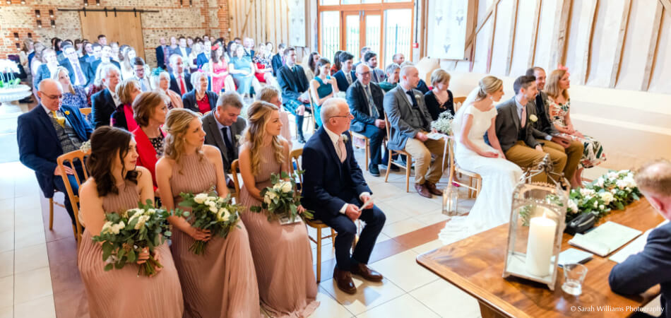 The wedding vows in the stunning East Barn at Upwaltham Barns