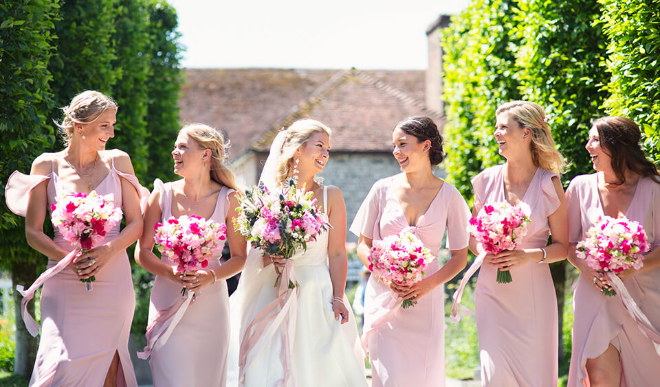 Bridal party in pastel pink dresses for a summer wedding
